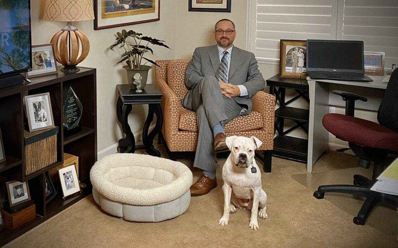 image of Neil with his dog Marlee in his office